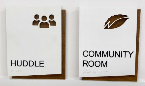 ADA CUSTOM DESIGN BRAILLE SIGNS FOR NASCENTIA HEALTH WITH ROUTED OUT PICTOGRAMS