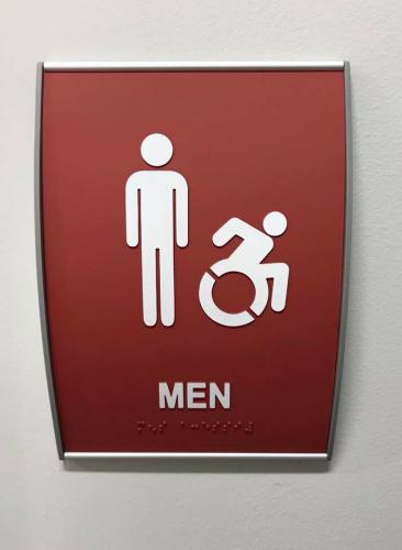 ADA BRAILLE RESTROOM SIGN IN REMOVABLE CURVED ALUMINUM FRAME
