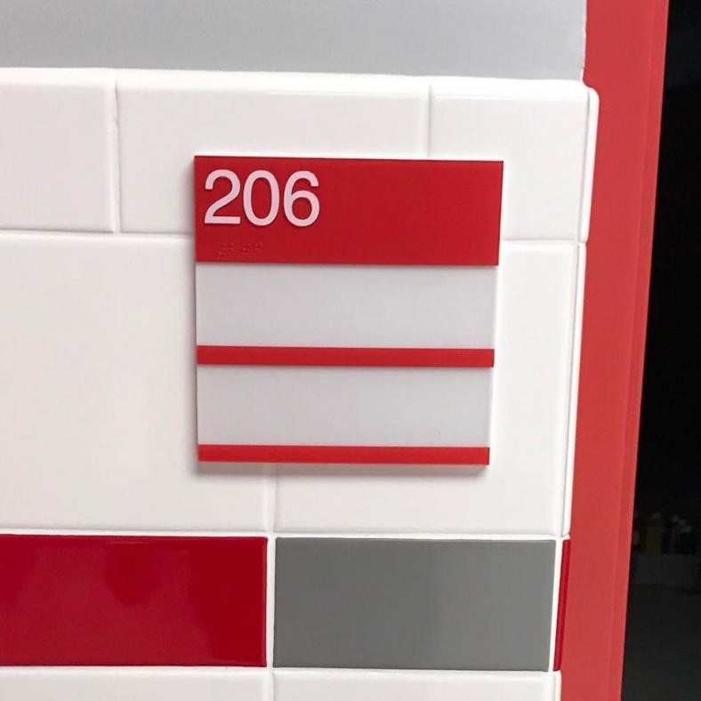 ADA PAINTED BRAILLE SIGN WITH 2 WINDOW SLOTS FOR REMOVABLE INSERTS AT CHENANGO VALLEY CSD